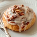 Quick and Easy Browned Butter Frosted Cinnamon Rolls with Pecans